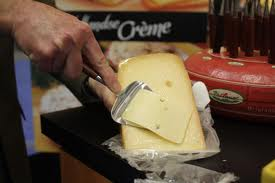 Slicing Parrano Cheese